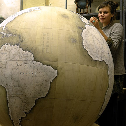 Jade Fenster hand-painting a globe at Bellerby & Co globemakers