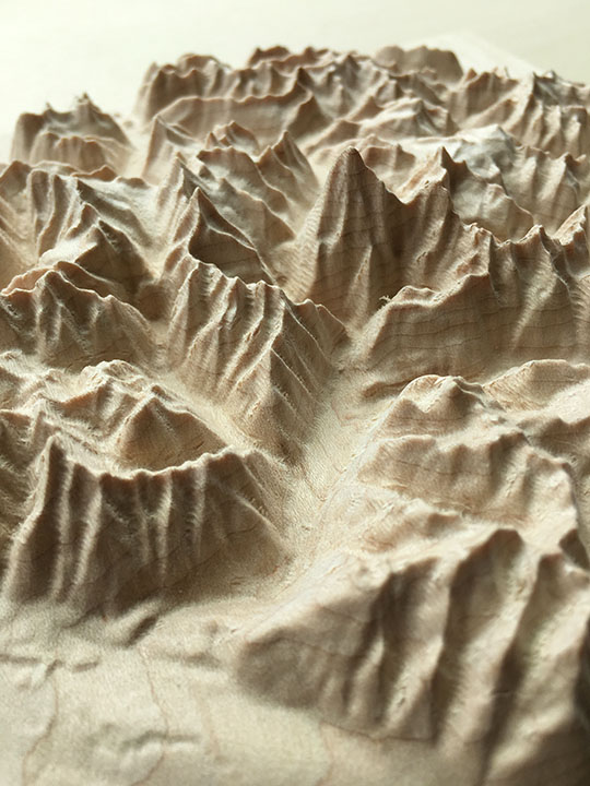 detail of three-dimensional wood-carved relief map of the Canadian Rockies around Mount Robson, British Columbia, Canada