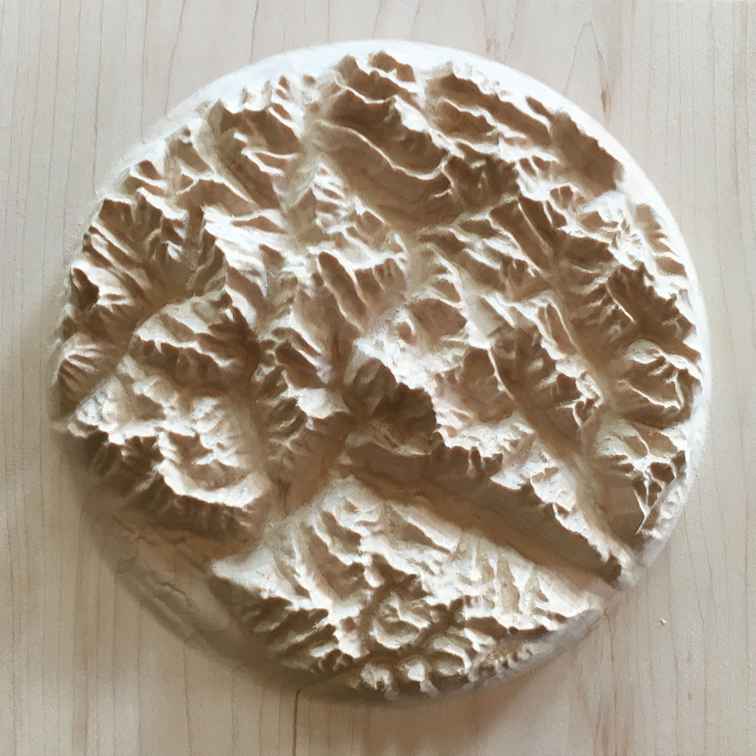 overview of three-dimensional wood-carved relief map of the Canadian Rockies around Mount Robson, British Columbia, Canada
