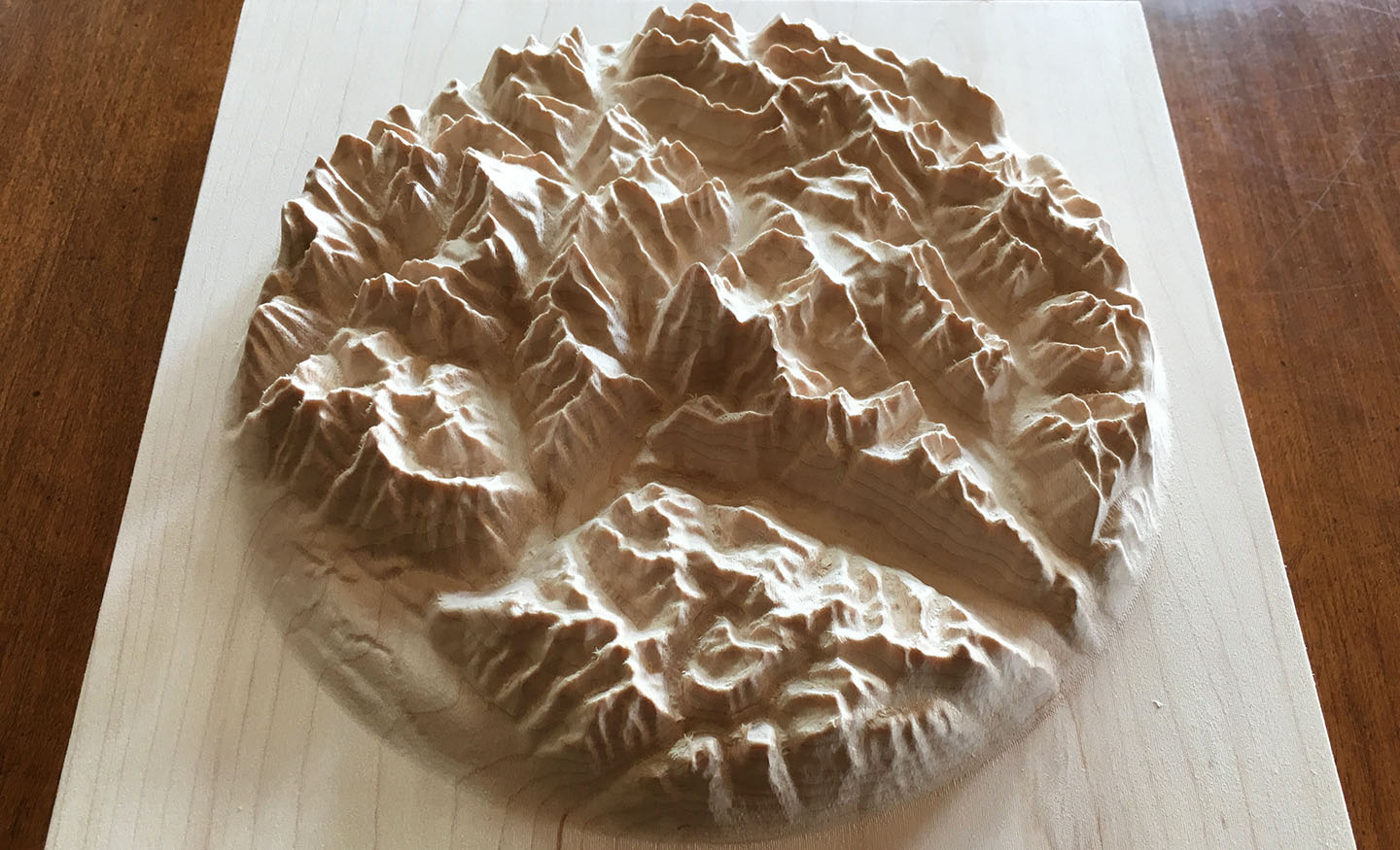three-dimensional wood-carved relief map of the Canadian Rockies around Mount Robson, British Columbia, Canada