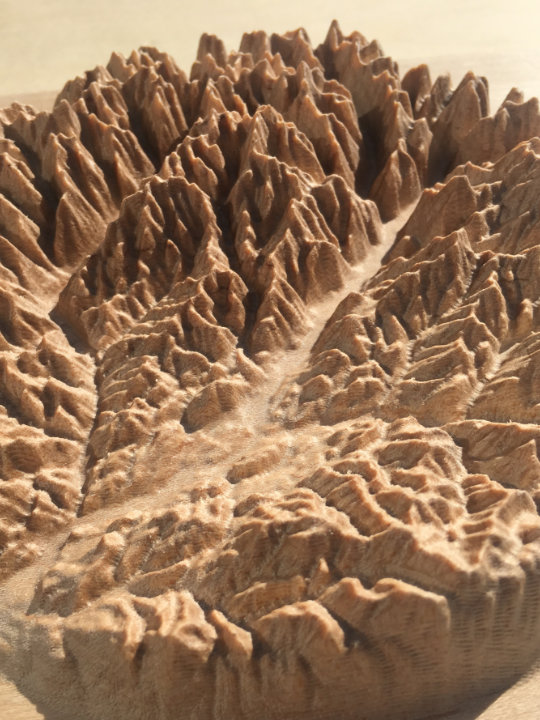 detail of three-dimensional wood-carved relief map of the mountains of the Methow Valley in the North Cascades, Washington, United States
