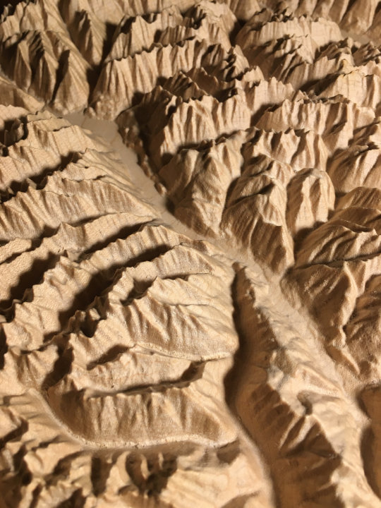 detail of three-dimensional wood-carved relief map of the mountains of Valhalla & Kokanee Glacier, British Columbia, Canada