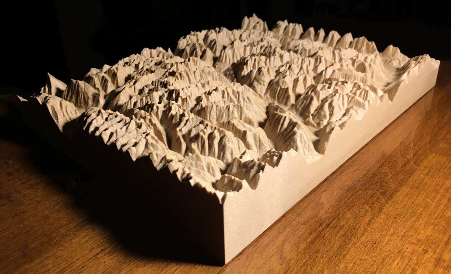 three-dimensional wood-carved relief map of the mountains of Valhalla & Kokanee Glacier, British Columbia, Canada