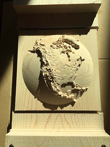 3D dome relief map of North America, carved out of wood