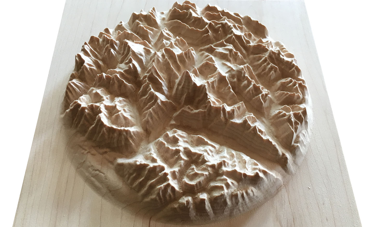 three-dimensional wooden relief carving of the mountains around Mount Robson, British Columbia, Canada